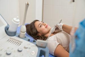 patient receiving a neck ultrasound